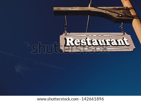 Restaurant Sign With Blue Sky - stock photo