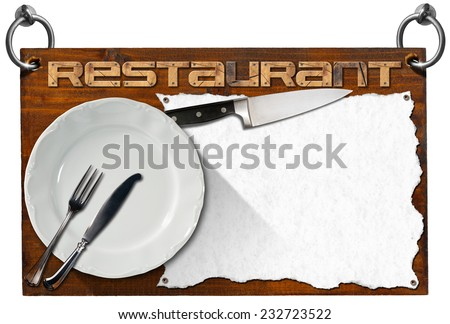 Restaurant Signboard with clipping path / Advertising dark wooden sign with clipping path for a restaurant with a white empty sheet of paper, kitchen knife, empty white plate and silver cutlery