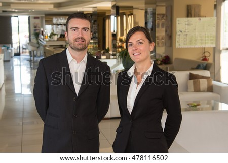 Restaurant staff portrait , man and woman