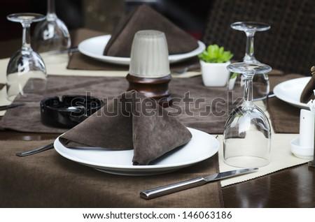 Restaurant table served for dinner - stock photo