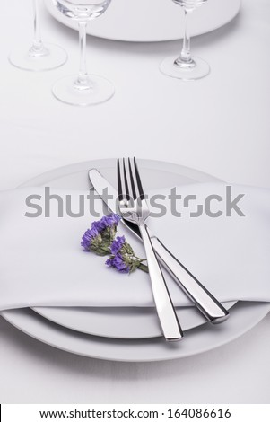 Restaurant table set with flowers - stock photo