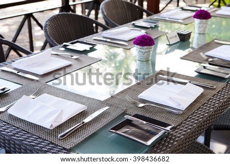 Restaurant table setting Copy space Outdoor summer tropical background - stock photo