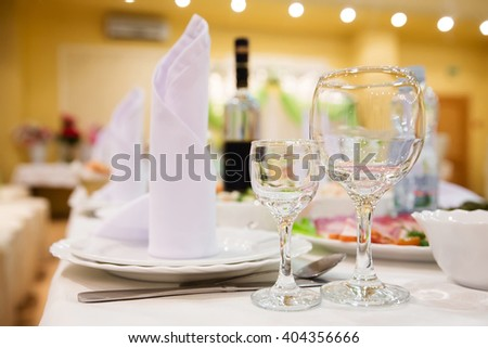 Restaurant table with glasses, napkins and cutlery
