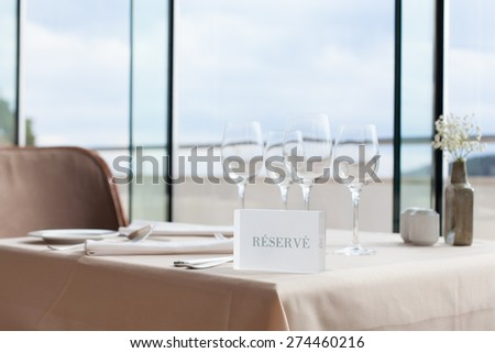 restaurant table with reserve sign - stock photo