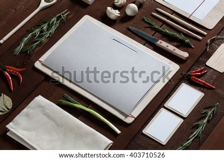 Restaurant utensil and menu on the wooden table, top view