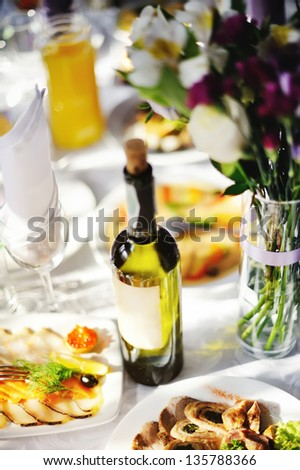 Restaurant. Wedding banquet, served table with a bottle of vine - stock photo