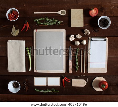 Restaurant wooden table with menu and utensil, top view - stock photo