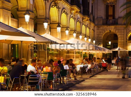 restaurants at Placa Reial in summer night. Barcelona, Catalonia - stock photo