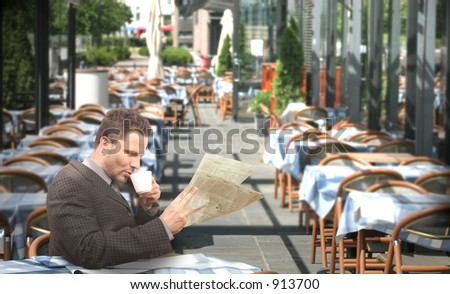 Resting businessman drinking coffee and reading newspaper in the restaurant - outside - stock photo
