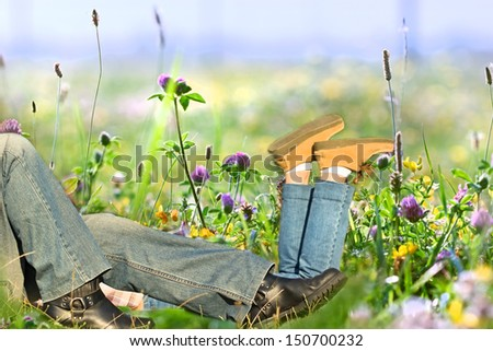 Resting on grass (outdoors) - stock photo