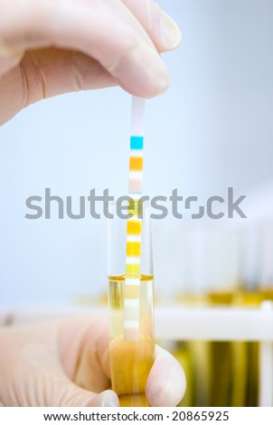 resting on specimen with comparison chart - stock photo