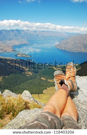 Resting on the summit of Ben Lomond, Queenstown, New Zealand - stock photo