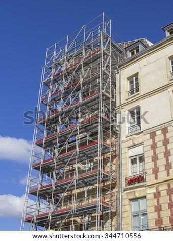 Restoration of house with scaffold