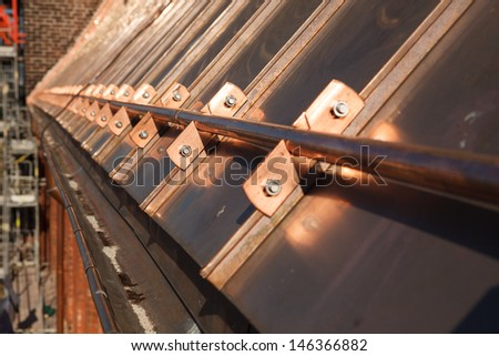 Restoration of old sopper roof of old gothic curch - stock photo