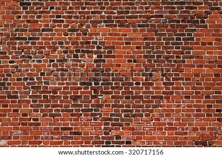 Restored brick wall texture. Architectural pattern of old and new bricks. - stock photo