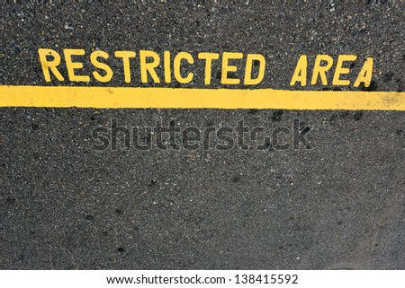 Restricted Area - Authorized Personnel Only -- sign posted on a road.