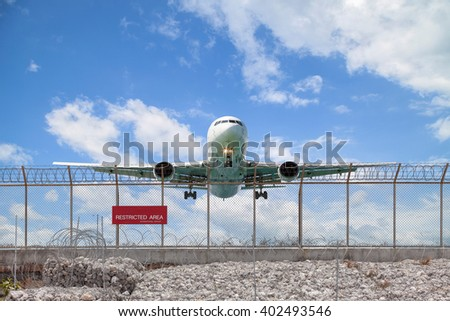 Restricted area fence  and Passenger airplane landing