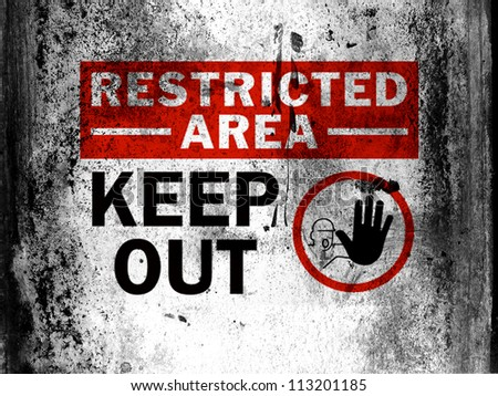 Restricted area sign painted on board with grungy dirty stains all over it