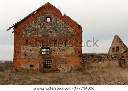 Rests of old brick barn, Belarus - stock photo