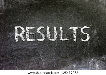 Results handwritten with white chalk on a blackboard. - stock photo