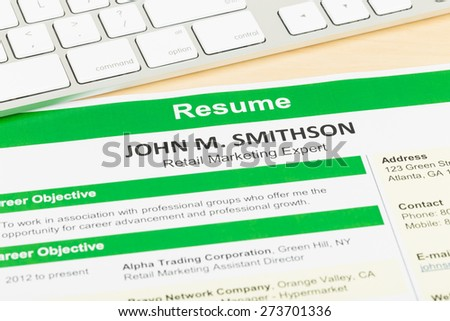 Resume with keyboard, document and information are mock-up - stock photo