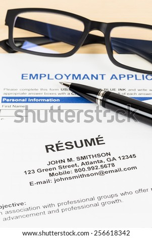 Resume with pen and glasses concept job applying; documents are mock-up - stock photo