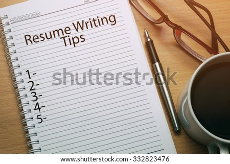 Resume Writing Tips written on notebook - business conceptual - stock photo