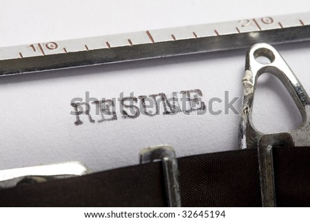 Resume written on old typewriter - stock photo
