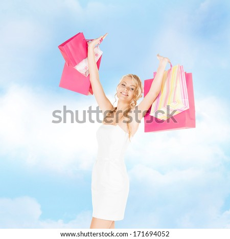 retail and sale concept - elegant woman in dress and high heels with shopping bags