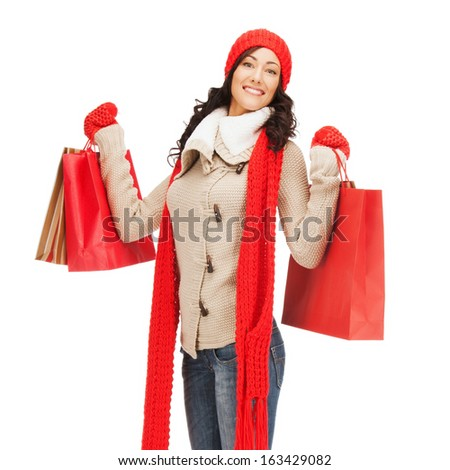 retail and sale concept - full-length picture of happy woman in winter clothes with shopping bags - stock photo