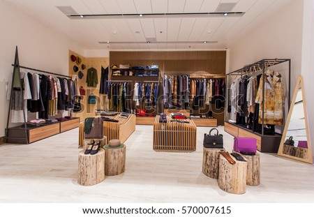 Retail clothes shop design interior 570007615 shutterstock for Clothing store interior design pictures