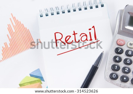 Retail - Financial accounting stock market graphs analysis. Calculator, notebook with blank sheet of paper, pen on chart. Top view - stock photo