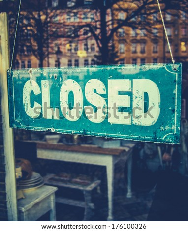 Retail Image Of Grungy Vintage Closed Sign In Furniture Boutique Store - stock photo