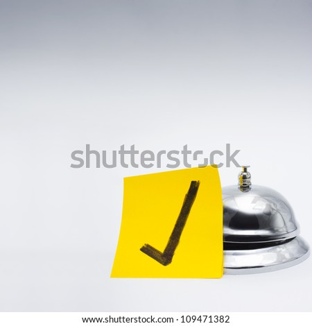 Retail service bell accompanied by a gold class approval tick in a depiction of good customer service - stock photo