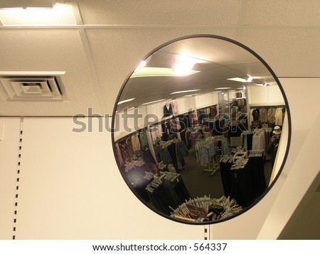 Retail store security mirror self portrait. - stock photo