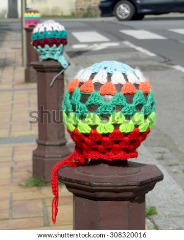 RETIERS, FRANCE, JULY 12 2015: An example of urban knitting or yarn bombing. A type of street art that employs displays of knitted or crocheted yarn. Originated in the U.S, it has now spread worldwide - stock photo