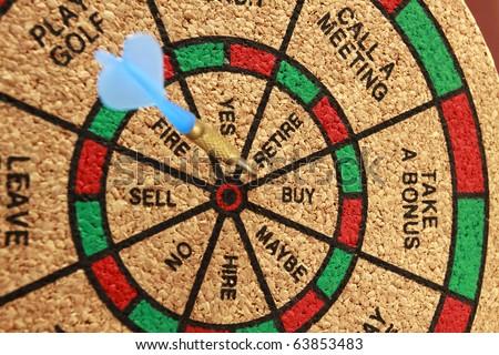 Retire A dart board with a dart in retire. Horizontal. - stock photo