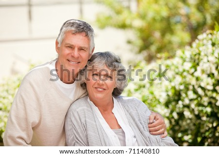Retired couple looking at the camera - stock photo