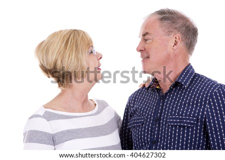 retired couple wearing casual outfits on white isolated background - stock photo