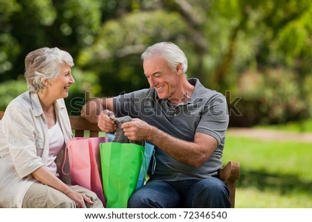 Retired couple with shopping bags - stock photo