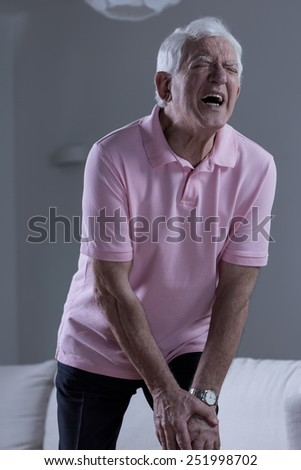 Retired man suffering for terrible pain of the knee - stock photo