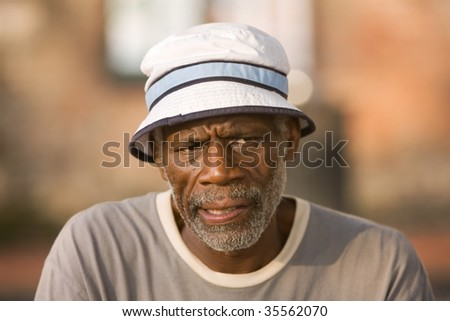Retired man thinking about what to do next - stock photo