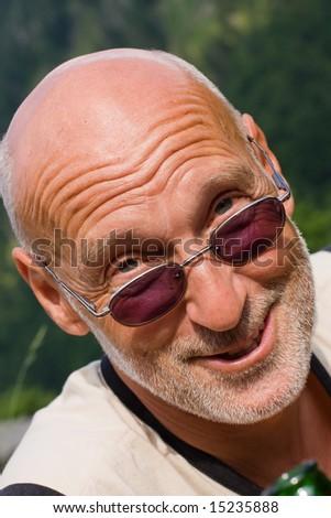 retired senior enjoying a beer - stock photo