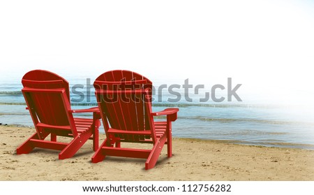 Retirement Aspirations and financial planning symbol with two empty blue adirondack chairs on a tropical sandy beach with ocean view as a business concept of future successful investment strategy. - stock photo