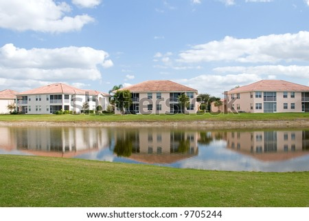 Retirement community condos on a resort golf course - stock photo