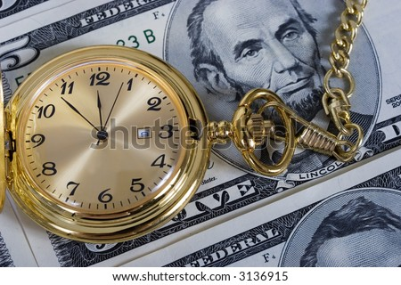 Retirement gold watch on a five dollar bill background - stock photo