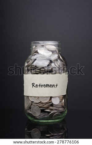 Retirement label on glass jar with coins - stock photo