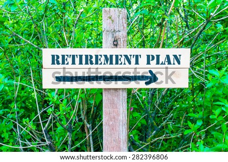 RETIREMENT PLAN written on Directional wooden sign with arrow pointing to the right against green leaves background. Concept image with available copy space - stock photo
