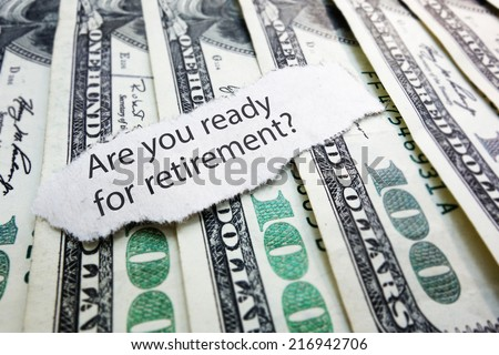 Retirement readiness newspaper headline on hundred dollar bills                                - stock photo