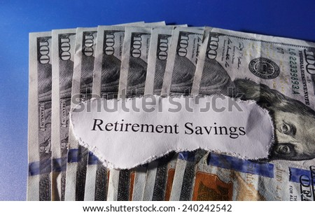 Retirement Savings note on assorted money                                - stock photo
